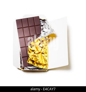 Chocolate bar wrapped in foil with open cardboard on white background - Stock Photo