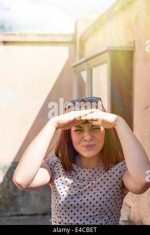 Young woman, hands covering eyes, Osijek, Croatia - Stock Photo