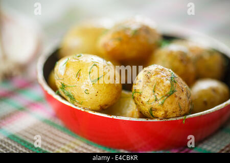roasted new potatoes in a pan on the table - Stock Photo