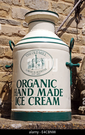 Organic hand made ice cream painted onto an old milk churn outside the entrance to the Old Mill, Lower Slaughter, - Stock Photo