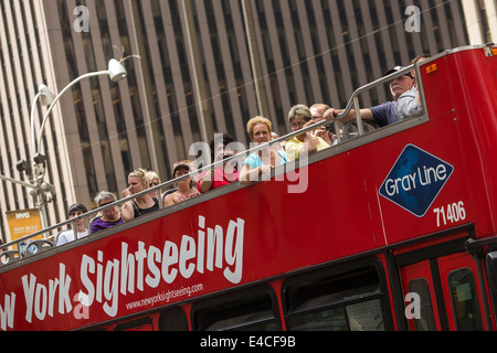 A New York Sightseeing bus is pictured in the New York City borough of Manhattan, NY - Stock Photo