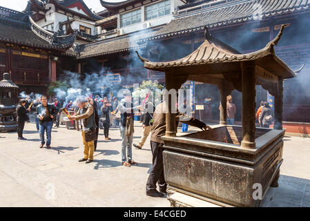incense burning in shanghai china old town temple - Stock Photo