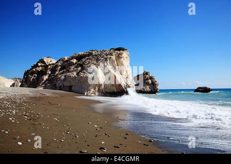 Rock of  Aphrodite (Petra Tou Romiou) the birthplace of Aphrodite the Greek goddess of love, on a shoreline beach - Stock Photo