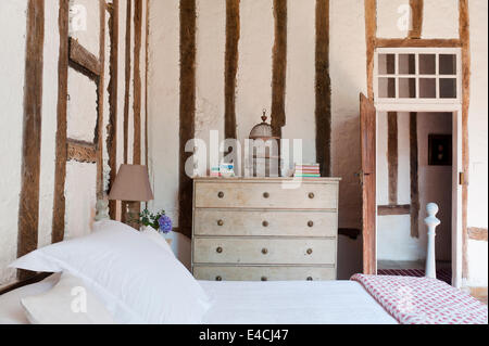 Bedroom with timber walls and bed in alcove Stock Photo: 181889831 ...