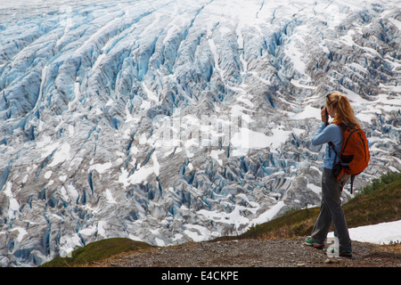 Woman hiking on the trail to Exit Glacier in the Harding Icefield