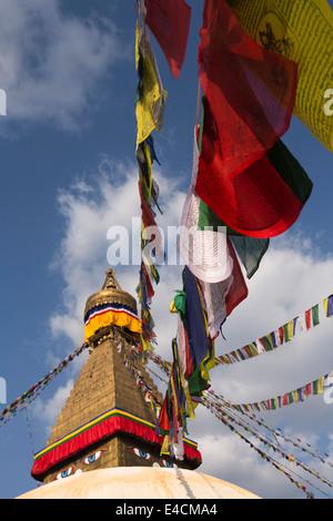 Nepal, Kathmandu, Boudhanath, stupa spire, with colourful prayer flags - Stock Photo