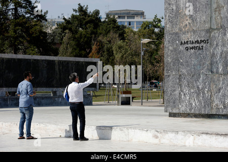 Tourists under the Alexander the Great statue in Thessaloniki, Greece - Stock Photo
