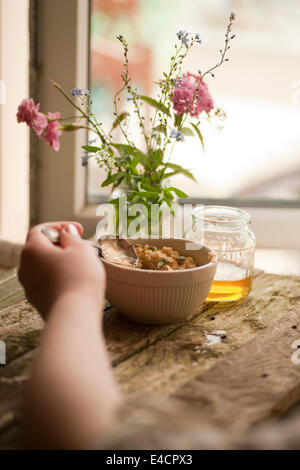 Porridge with Sunflower Seeds and a Light Syrup. - Stock Photo