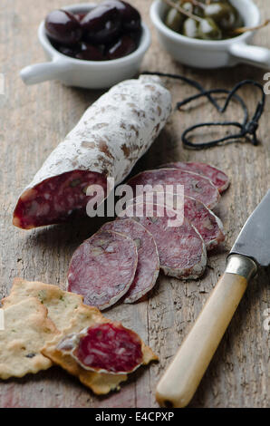 Salami on a wooden board - Stock Photo