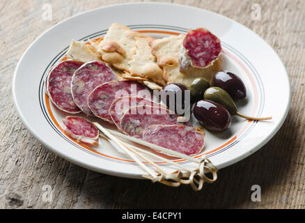 Salami on a white plate - Stock Photo