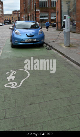 The future now... Plug in and Go. Electric Charging bays in the Merchant City, Glasgow - Stock Photo