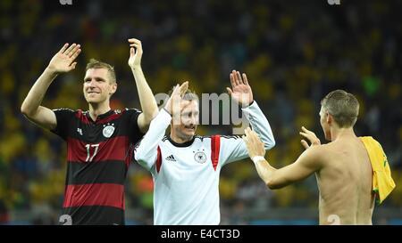Belo Horizonte, Brazil. 8th July, 2014. Germany's Per Mertesacker (L), Miroslav Klose (C) and Bastian Schweinsteiger - Stock Photo