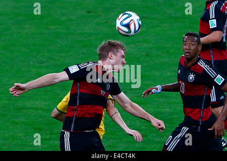 Belo Horizonte, Brazil. 8th July, 2014. Germany's Per Mertesacker (front, L) heads the ball during a semifinal match - Stock Photo