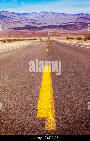 Long road in Death Valley with Instagram filter. - Stock Photo