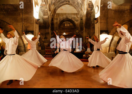 Whirling Dervishes of the Mevlevi Order, Sema ceremony, Saruhan Caravanserai, Sarıhan, near Avanos, Cappadocia - Stock Photo