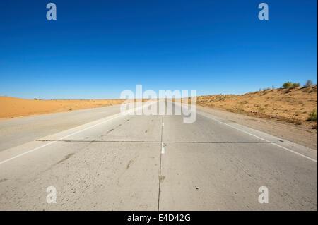 Road in the Kyzyl Kum desert, Uzbekistan - Stock Photo