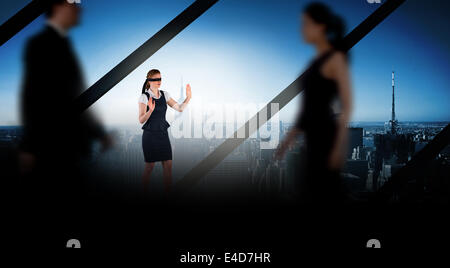 Composite image of business people walking in a blur - Stock Photo