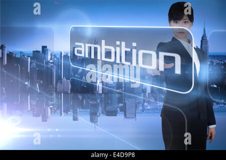 Businesswoman pointing to the word ambition - Stock Photo