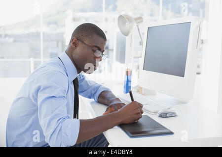 Focused businessman working at his desk - Stock Photo