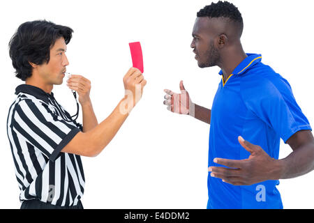 Referee sending off football player - Stock Photo