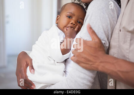 Happy parents spending time with baby - Stock Photo