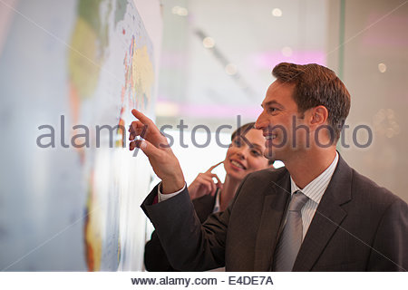 Businessman looking at world map - Stock Photo