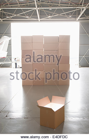 Stack of boxes in hangar - Stock Photo