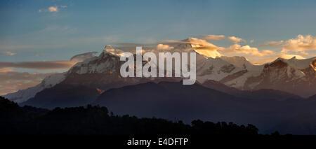 Nepal, Pokhara, Annapurna Range, at dawn in first light from Pokhara, panoramic - Stock Photo