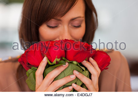 Woman smelling roses - Stock Photo