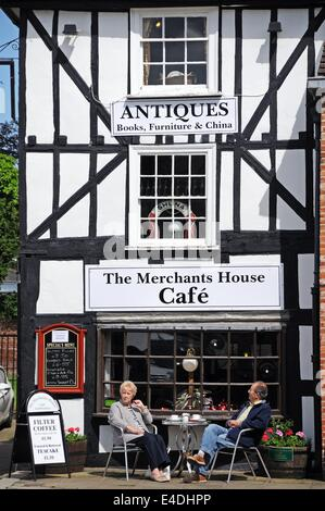 Couple sitting at a table outside The Merchants House cafe in Corn Square, Leominster, Herefordshire, England, UK, - Stock Photo