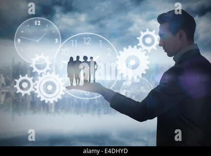 Composite image of business team looking at camera - Stock Photo