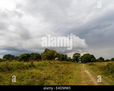 Thunderstorm, probably over Chichester, from Bignor Hill, West Sussex, England, UK, on the South Downs Way - Stock Photo