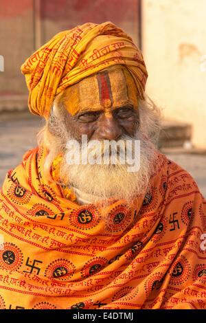 VARANASI, INDIA - MARCH 2014: Sadhu, holy man sits at the banks of Ganges in Varanasi March 2014 - Stock Photo