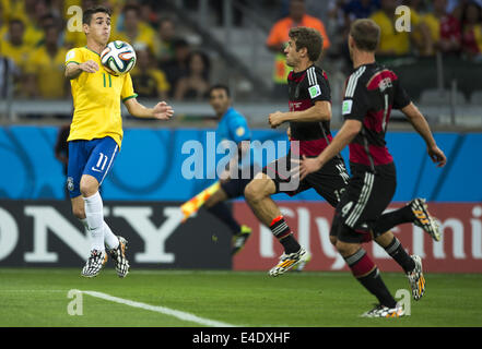 Belo Horizonte, Brazil. 8th July, 2014.  Oscar and Thomas Muller in semifinal match between Brazil and Germany, - Stock Photo