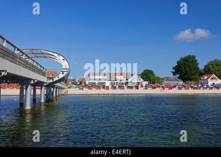 Sea bridge and roofed wicker beach chairs along the Baltic Sea at Kellenhusen, Schleswig-Holstein, Germany - Stock Photo