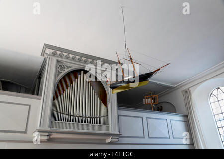 Votive ship model and organ in Gilleleje Church, North Zealand, Denmark - Stock Photo