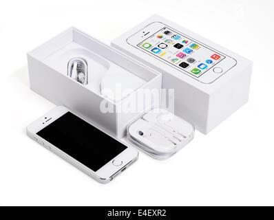 An Apple iPhone 5s with the original packaging - Stock Photo