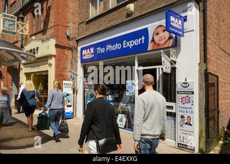 People in front of a Max Spielmann photo store - Stock Photo