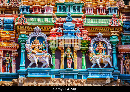 Shiva and Parvati on bull images. Sculptures on Hindu temple gopura (tower). Minakshi Temple, Madurai, Tamil Nadu, - Stock Photo