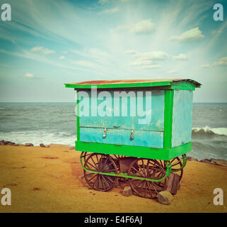 Vintage retro hipster style travel image of cart on beach. Tamil Nadu, India - Stock Photo
