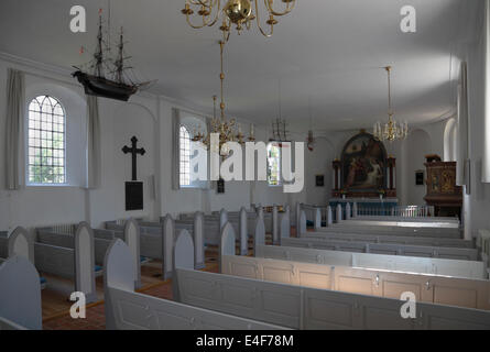 Nave, votive ship model, pews, pulpit and altar in Gilleleje Church, North Zealand, Denmark. Part of Jewish history - Stock Photo