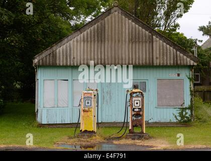 Derelict petrol station and pumps in Brora, Scotland, UK - Stock Photo