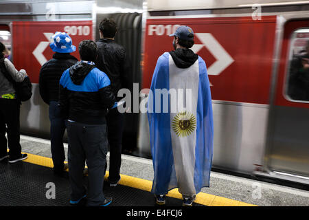 São Paulo, Brazil. 9th July, 2014. Argentina fans wait for a train in the Itaquera train station after the semifinal - Stock Photo