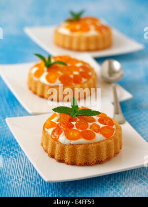 Tartlets with cheese and kumquats. Recipe available. - Stock Photo