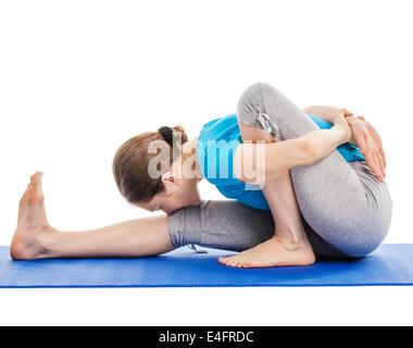 Yoga - young beautiful slender woman yoga instructor doing Forward Bends Sage Twist A pose (Marichyasana A) asana - Stock Photo