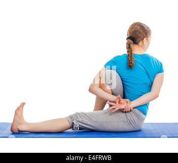 woman marichyasana yoga sage pose posture position in