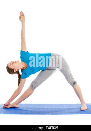 Yoga - young beautiful slender woman  yoga instructor doing Triangle asana pose (utthita trikonasana) in ashtanga - Stock Photo
