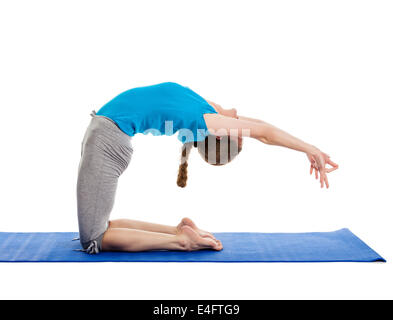 young woman doing yoga advanced asana stock photo