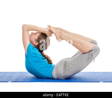 Yoga - young beautiful slender woman yoga instructor doing Bow pose (Balancing on abdomen in the shape of a bow) - Stock Photo