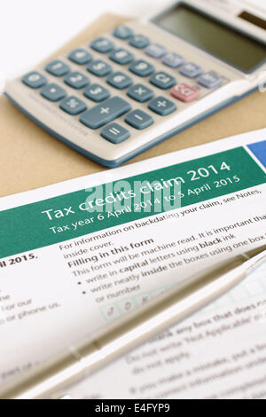 Completing a British working tax credit application concept - Stock Photo